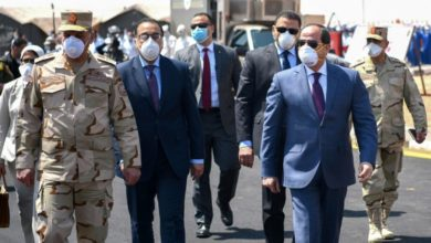 Egypt's President Abdel Fattah el-Sisi, right, during a visit to the Huckstep military base east of the capital Cairo on 7 April (AFP)